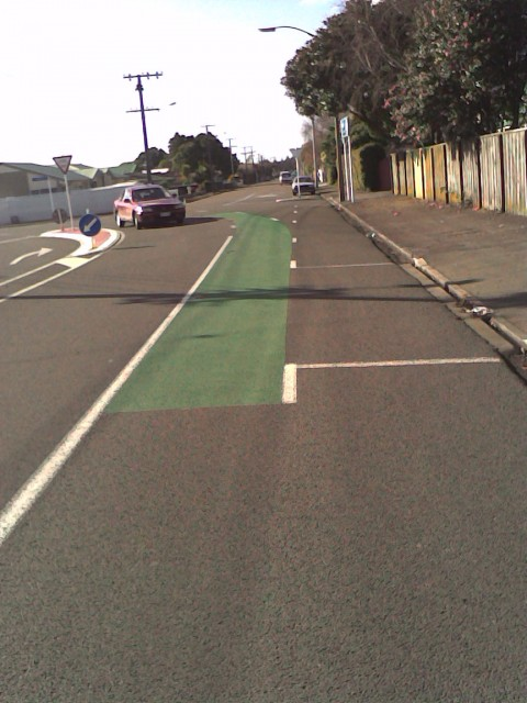Green paint marking in cycle lanes: Top of Tukapa St and into Wallace Place