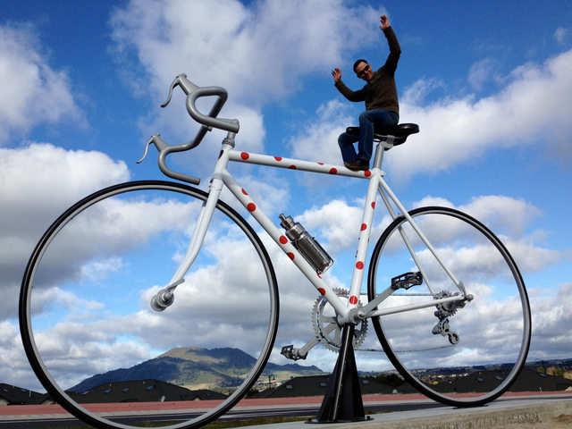 Giant cycle in Taupo: Photo caption: Artist Marcel Zwezerijnen created a three metre high sculpture permanently sited at the Northern entrance of Taupo to inform locals and visitors that Taupo is a cycling town and remind drivers they need to be aware of cyclists on our roads